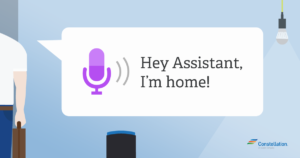 Person saying Hey Assistant, I'm home! to trigger a Google assistant routine or Amazon routine.